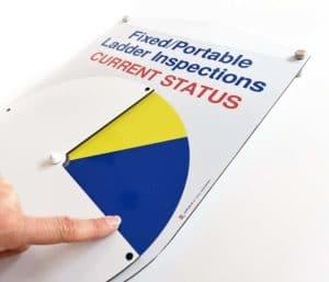 Lockable status indicator dial shield
